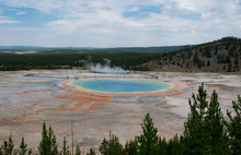 God's Eye - The Multi-colored Hot Spring With Bright Hues Of Orange, Yellow, And Green Ring With Deep Blue Waters In The Spring