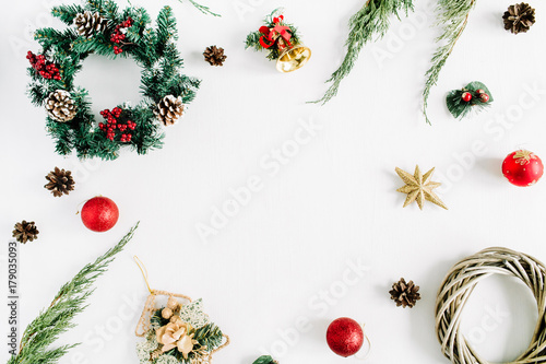 Fotografija  Frame made of Christmas decorations on white background