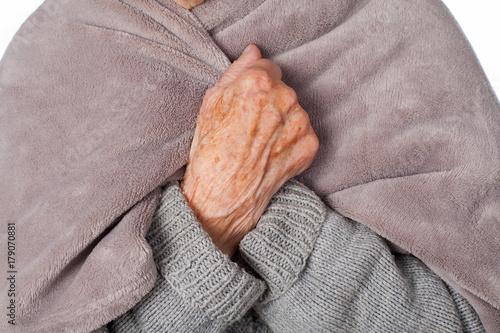 Elderly ill woman with blanket Wallpaper Mural