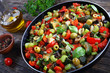 tasty Caponata with vegetables on skillet