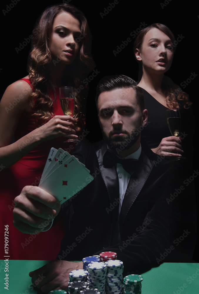concentrated men and women playing poker in casino плакат