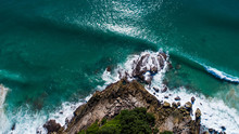 Aerial Drone Top View Of Beautiful Tropical Island And Sea Waves Crashing Coastline Cliff During Sunny Summer Day