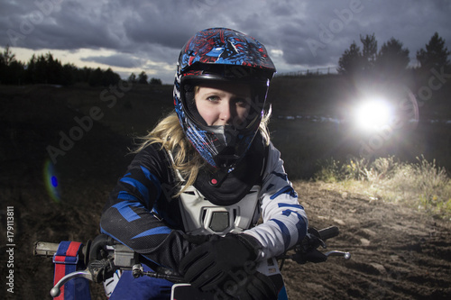 A portrait of motocross rider on the track.