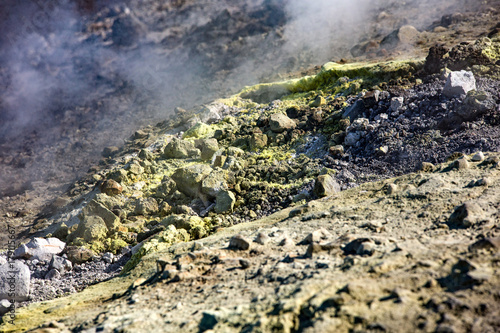 Keuken foto achterwand Aubergine Sulfur haze and crystals on the rocks. Volcano or Vulcano Island in the archipelago of Aeolian Islands close to Sicily - Italy.
