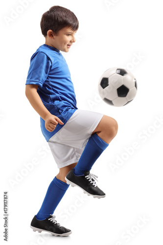 Little footballer juggling a football
