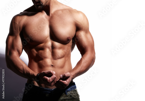 Photo Portrait of strong healthy handsome Athletic Man Fitness Model isolated on white