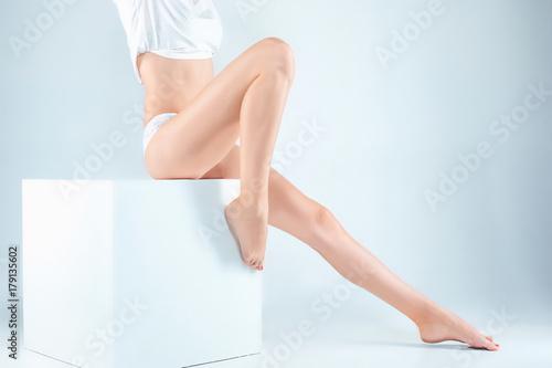 Fototapeta Perfect female legs in underwear. obraz na płótnie