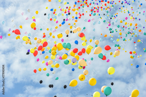 Fototapeta Multicolored balloons flying to the sky