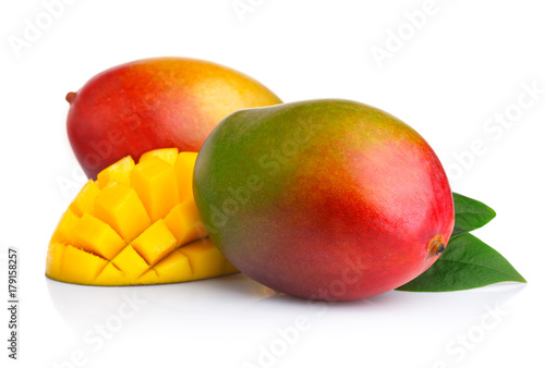 Ripe mango fruits with slices isolated on white