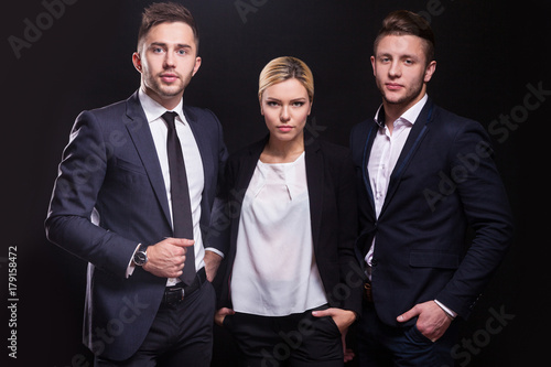 Photo  Picture of young trio of office workers standing