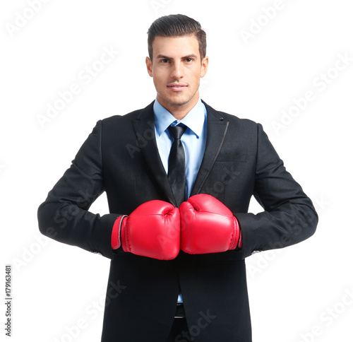 Fototapety, obrazy: Businessman in boxing gloves on white background