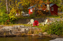 Red Cottage On Rocky Shore