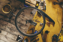High Angle Shot Of Bicycle Wheel Attached To A Clamp