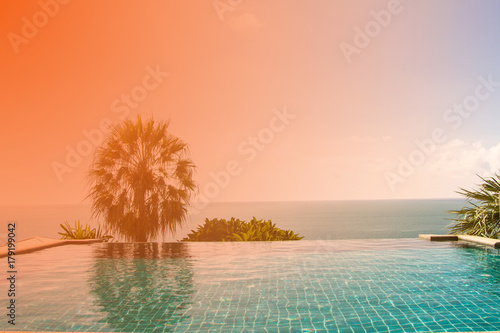 Deurstickers Koraal Swimming pool looking at blue sea view and blue sky background