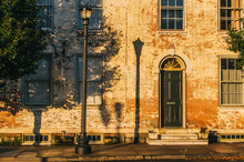 Old Brick Building With Shadows At Sunset