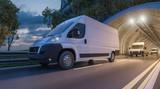 Fototapeta Miasto - Several Delivery Vans Passing through a Tunnel