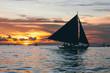 Sailboat on the sea at sunset