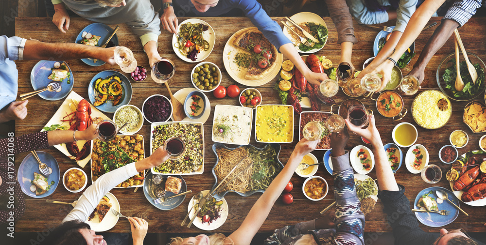 Fototapety, obrazy: Group of diverse people are having lunch together