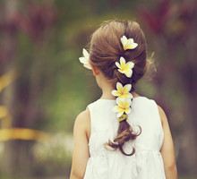 Child`s Hair With Frangipani Flowers In It