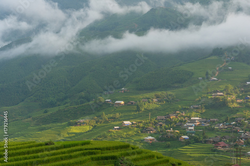 Foto  Picturesque mountain village and rice terraces