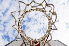 Basketball Stands Under Blue Sky With White Clouds