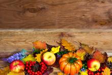 Thanksgiving Centerpiece With Oak Leaves, Pumpkin, Apple, Lilac Flowers