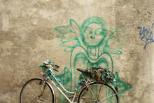 Old Bicycle Against Wall With ...