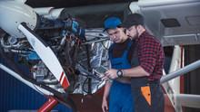 Two Flight Mechanics Doing A P...