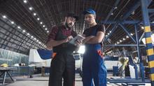 Two Flight Engineers Walking T...