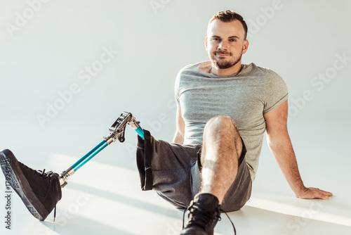 smiling man with leg prosthesis Wallpaper Mural