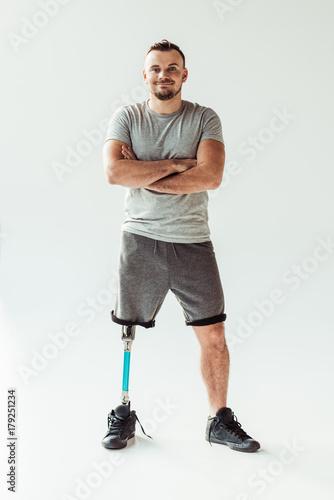 smiling man with leg prosthesis Canvas Print