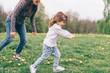 mum playing daughter outdoor park