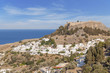 Castle view Acropolis of city Lindos of Rhodes island with big blue cloudy sky