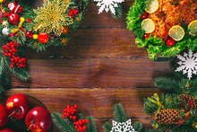 Christmas Table Dinner Time With Roasted Meats Decorated In Christmas Style. Background Thanksgiving. The Concept Of A Family Holiday, Beautiful Delicious Food. Frame With Free Space