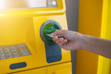 Hand Inserting ATM Card Into B...
