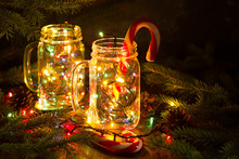 Christmas Fairy Garland Lights In A Glass Jar Shine In The Night Darkness.