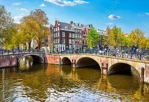 Fototapety, obrazy: Bridge over channel in Amsterdam Netherlands houses river Amstel