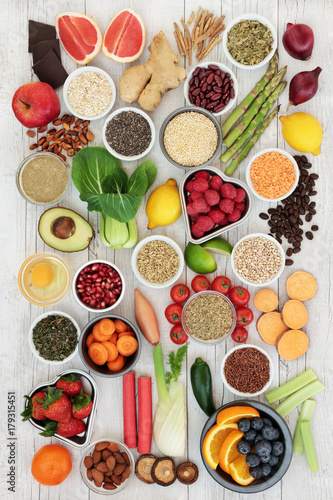 Fototapety, obrazy: Diet super food  ingredients with herbs used as appetite suppressants, fruit, vegetables, nuts, seeds, grains cereals and legumes. Super foods high in antioxidants, anthocyanins, fibre and vitamins.