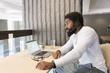 Man with headphones using laptop
