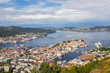 Bergen City, Scenic Aerial View Panorama harbour Cityscape under Dramatic Sky at sunset summer from Top of Mount Floyen Glass Balcony Viewpoint mountain