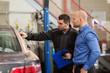 auto mechanic and customer at car shop