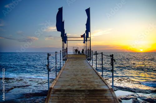 Fototapety, obrazy: Sea pier at sunset