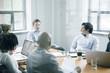 Business people talking behind window in meeting