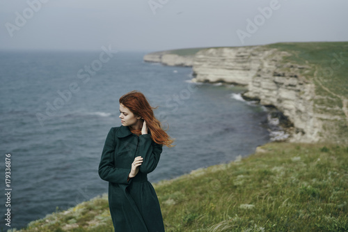Fotobehang Fantasie Landschap Caucasian woman standing near ocean