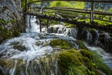 Wooden Footbridge Over Waterfall