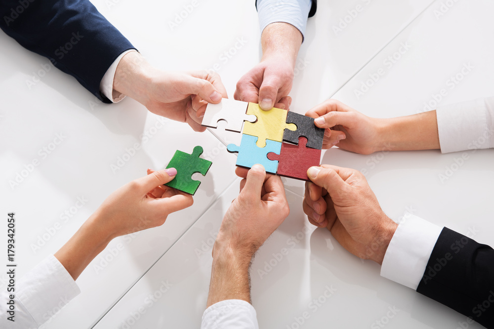 Fototapeta Teamwork of partners. Concept of integration and startup with puzzle pieces
