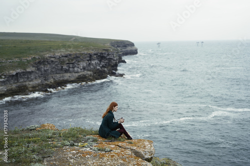 In de dag Fantasie Landschap Caucasian woman examining camera near ocean