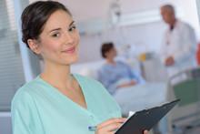 Portrait Of Nurse Holding Clip...