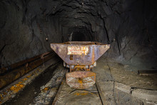 Underground Abandoned Ore Mine Shaft Tunnel Gallery With Ore Cart
