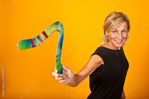 фотография  woman posing with a boomerang